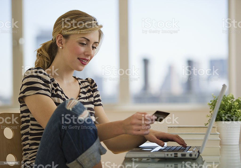 female shopping online from home stock photo