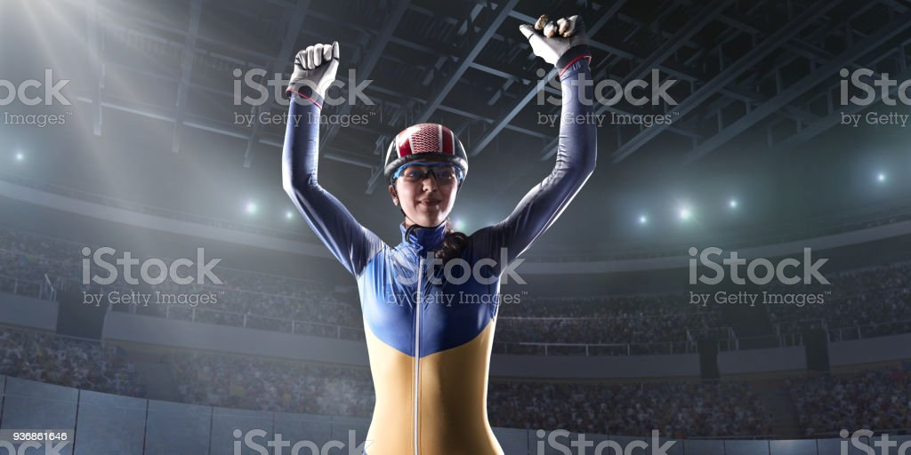 Female Short Track athlete rejoices in victory in professional ice arena stock photo