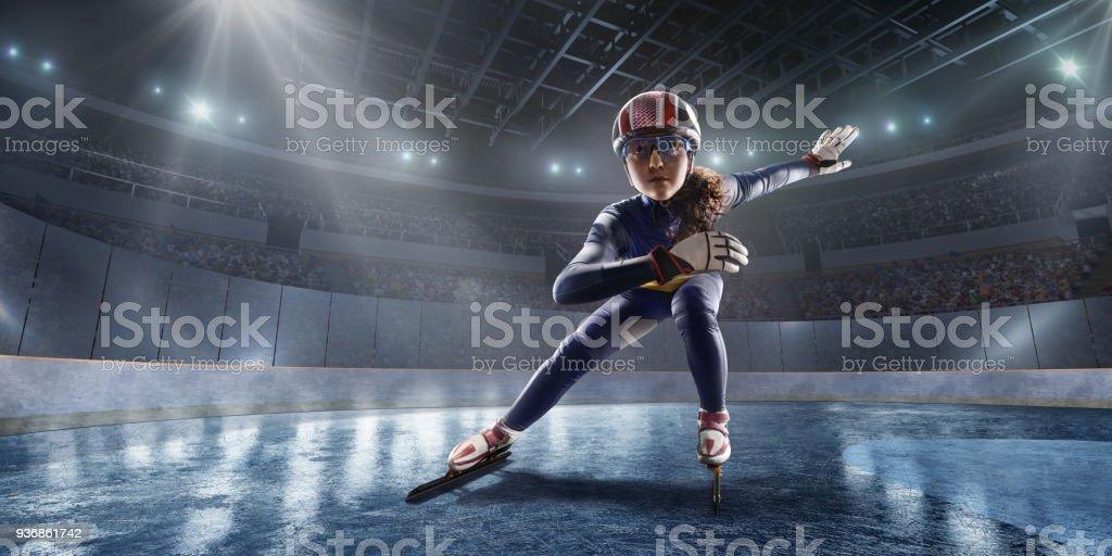 Female Short Track athlete slide in professional ice arena stock photo