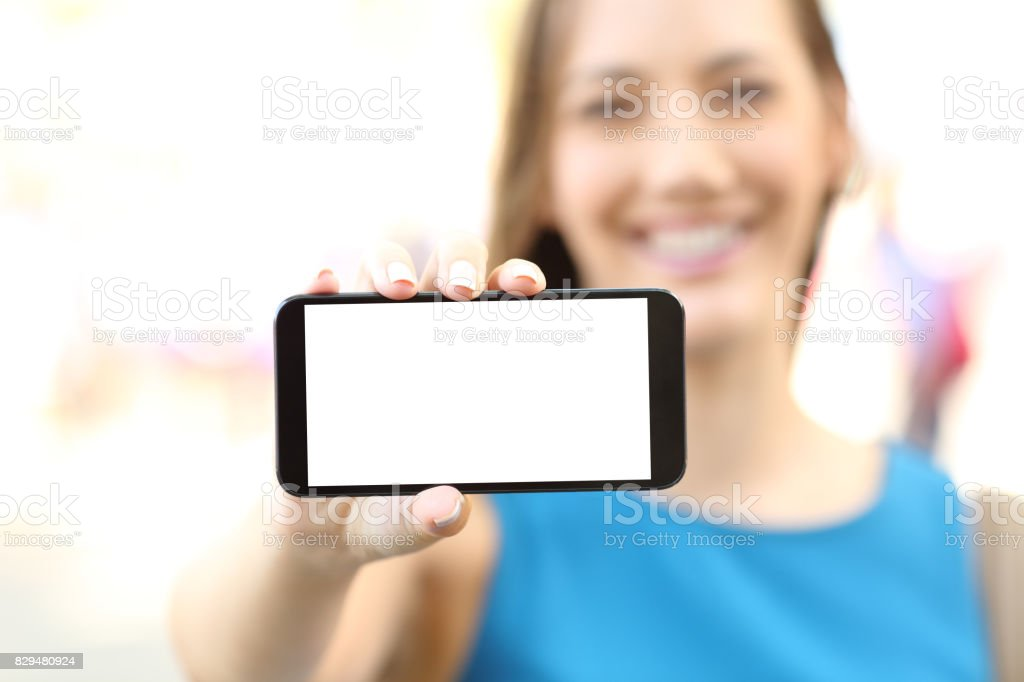 Female showing a blank horizontal phone screen stock photo