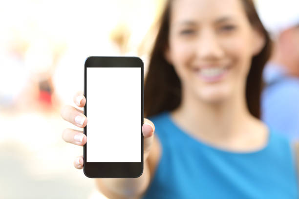 Female showing a blank vertical phone screen stock photo