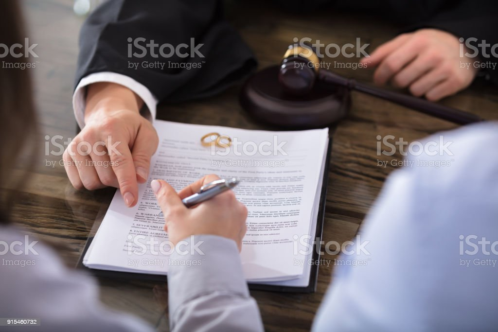 Female Signing Contract stock photo