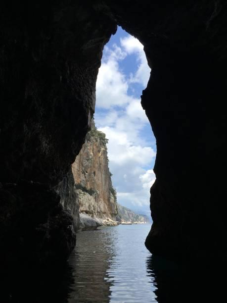 female silhouette between rocks stock photo