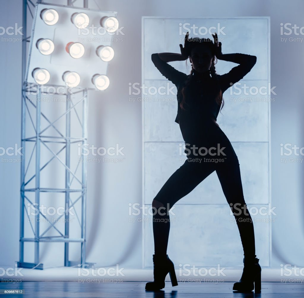 Female Silhouette. Dancing In Vogue Style stock photo