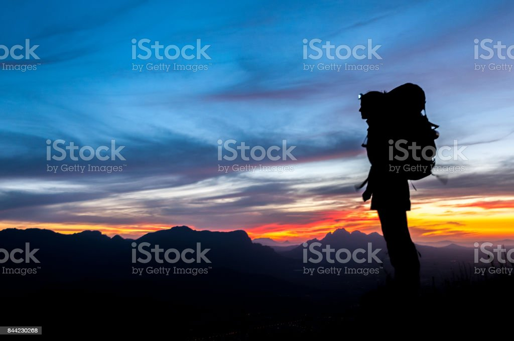Female Silhouette Hiker stock photo