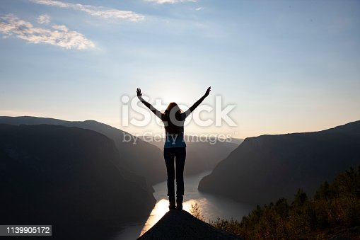 istock Female silhouette on summit 1139905172