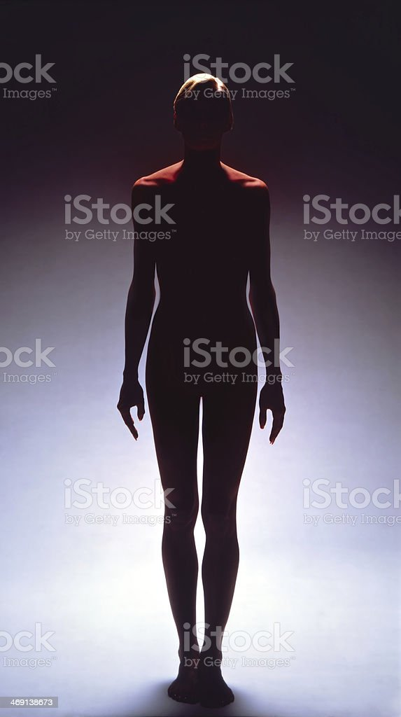 Female Silhouette Top Lit in Red stock photo