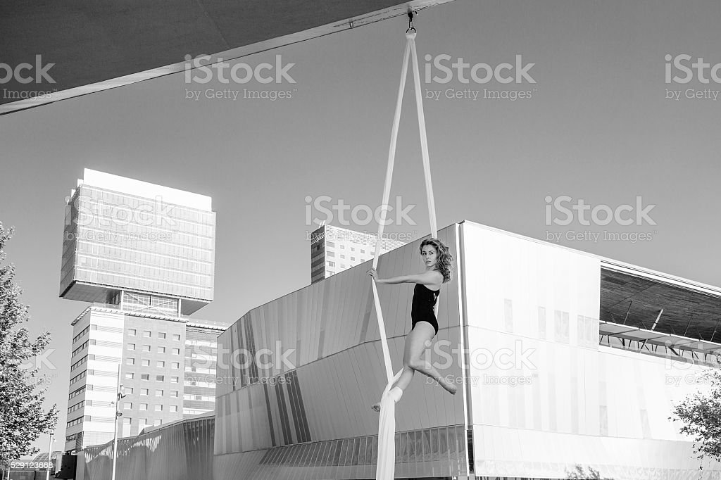 Female silk aerial dancer stock photo