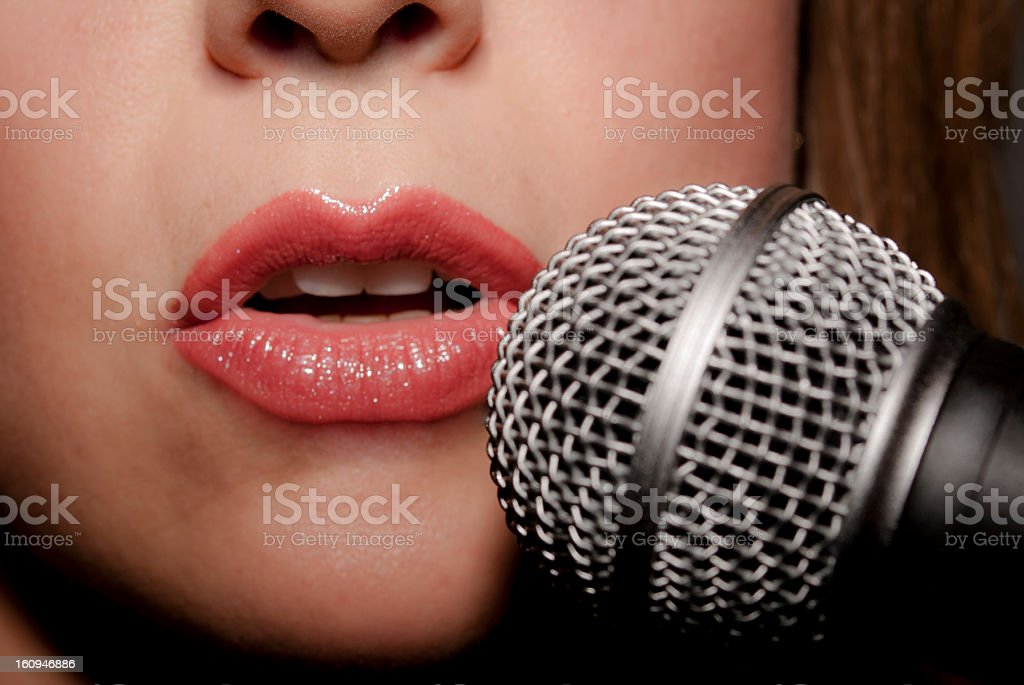 Female singer and microphone stock photo