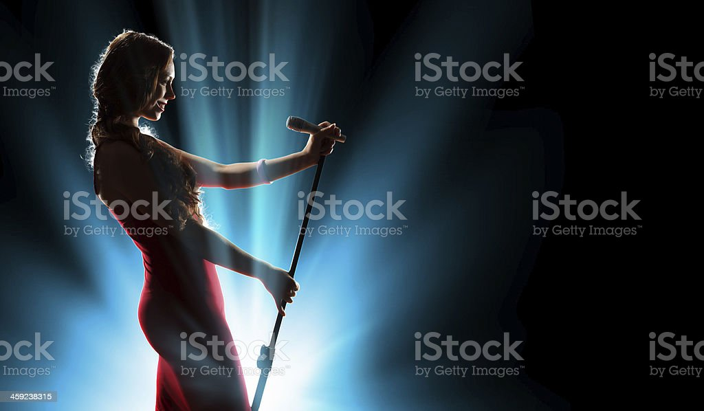 Female singer on the stage stock photo