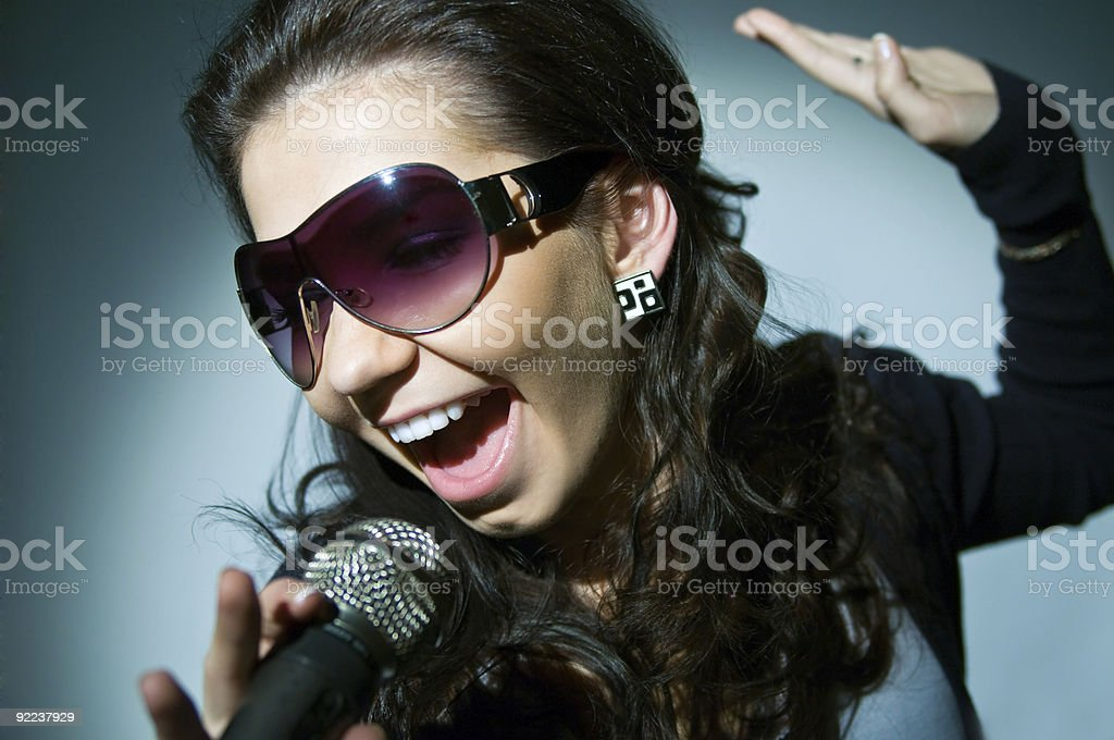 Female singing enthusiastically royalty-free stock photo