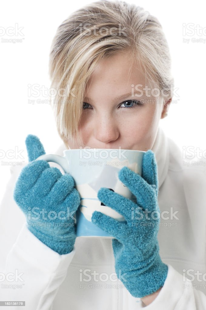 Female Sips Hot Chocolate or Coffee from a Mug Pretty blond drinking hot chocolate or coffee from a mug wearing a white fleece pullover and teal gloves.Similar images: Beautiful People Stock Photo