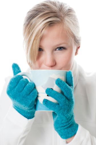 Female Sips Hot Chocolate Or Coffee From A Mug Stock Photo - Download Image Now