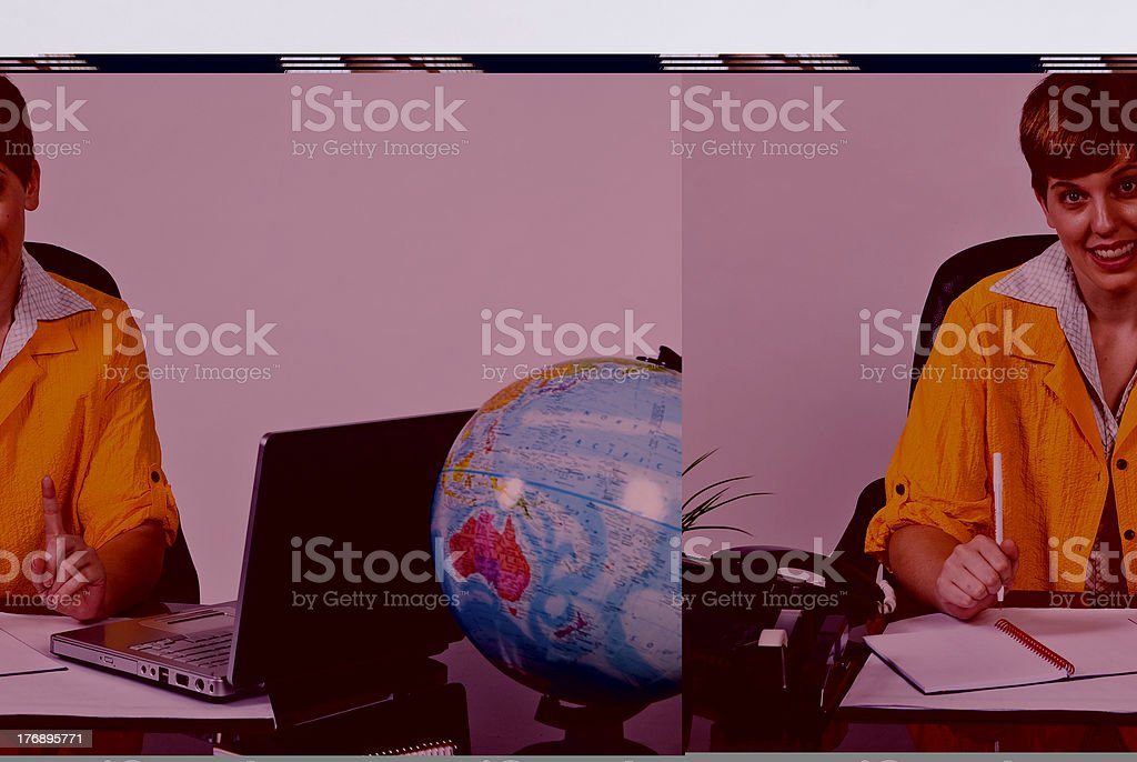 Female sitting behind a desk stock photo