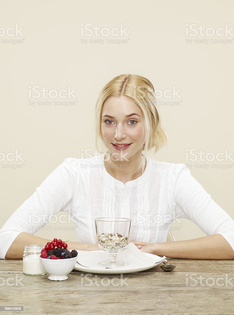 female sitting in front of a healthy breakfast foto de stock libre de derechos