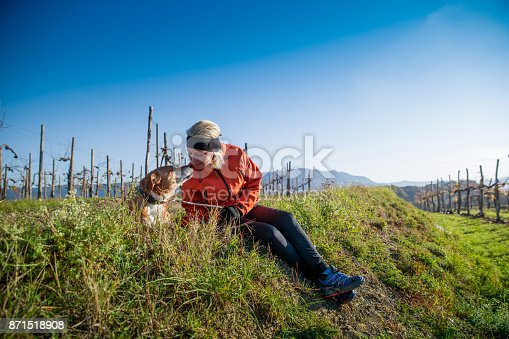 Female Sitting in Meadow with her Dog in the Morning