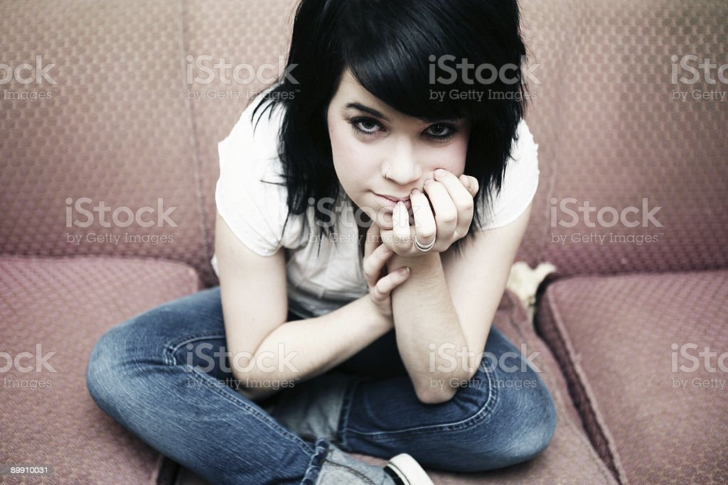 Female Sitting on Couch Portrait royalty-free stock photo