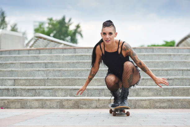 female skateboarder - punk music stock photos and pictures
