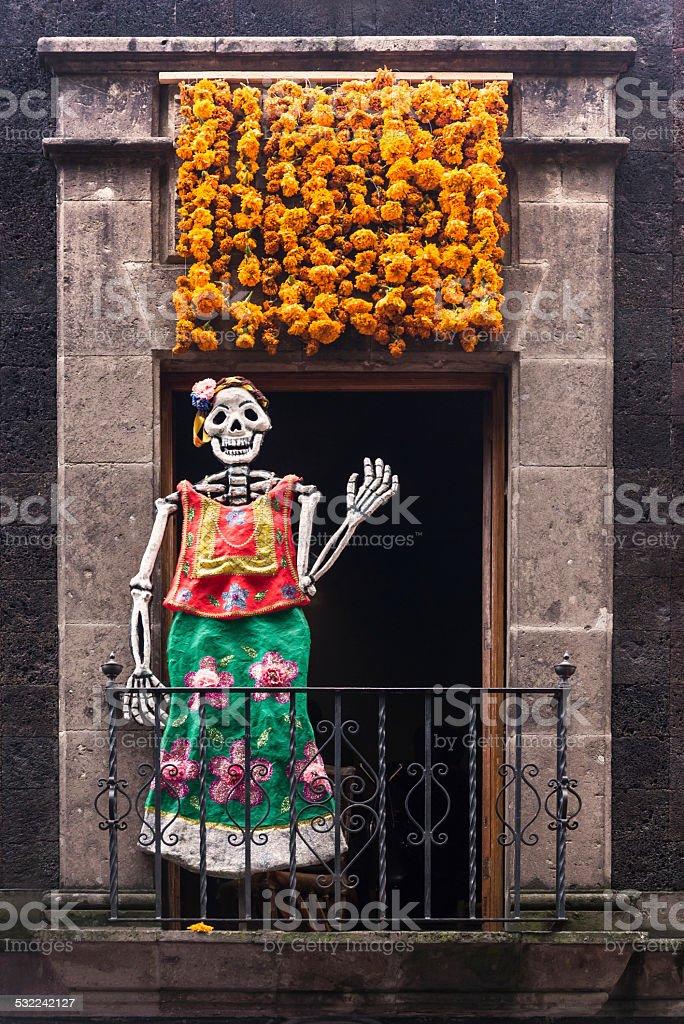 Female skeleton waving on a balcony stock photo