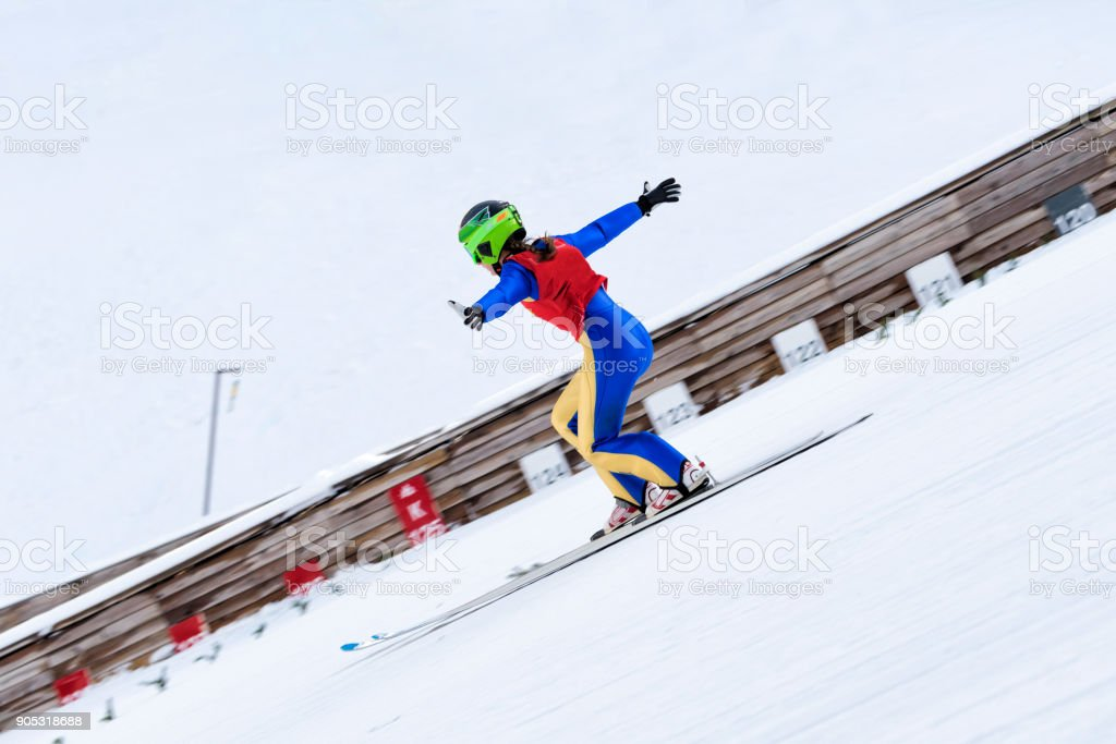 Female Ski Jumper Practicing Telemark Landing, stock photo