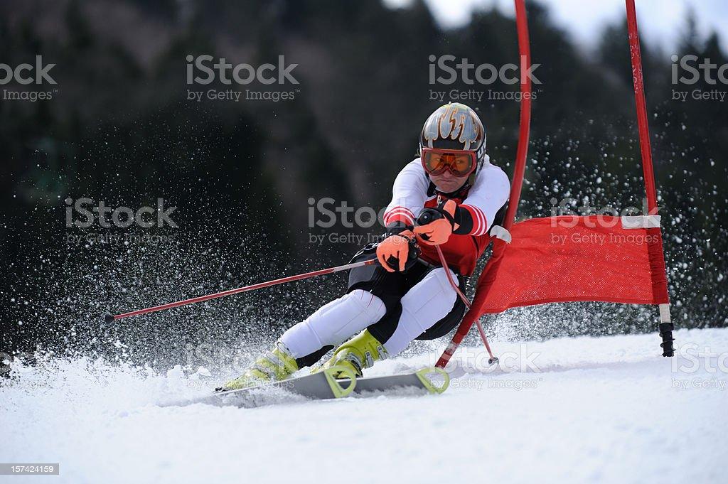 Female skier at giant slalom stock photo