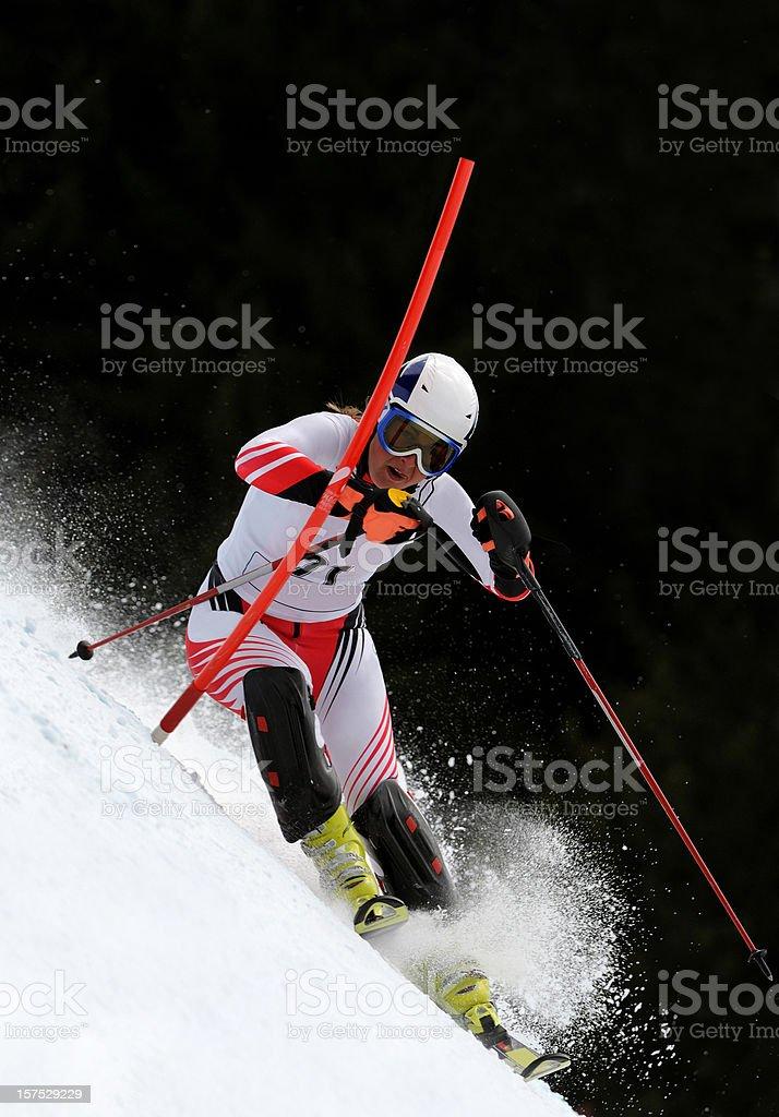 Female skier at slalom race stock photo