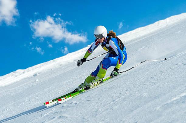 Female Skier at Straight Downhill Ski Race stock photo