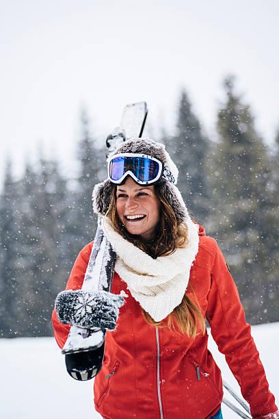 Female skier enjoying snow stock photo
