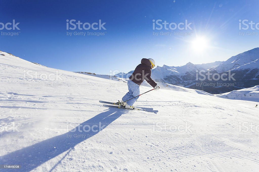 Female Skier in Action and Mountain View royalty-free stock photo