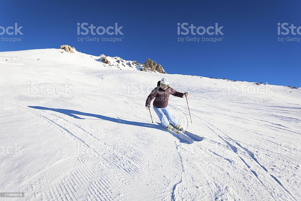 Female Skier in Action on Swiss Alps royalty-free stock photo