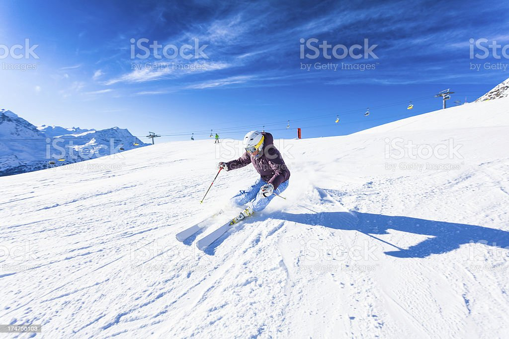 Female Skier in Action on the Alps royalty-free stock photo