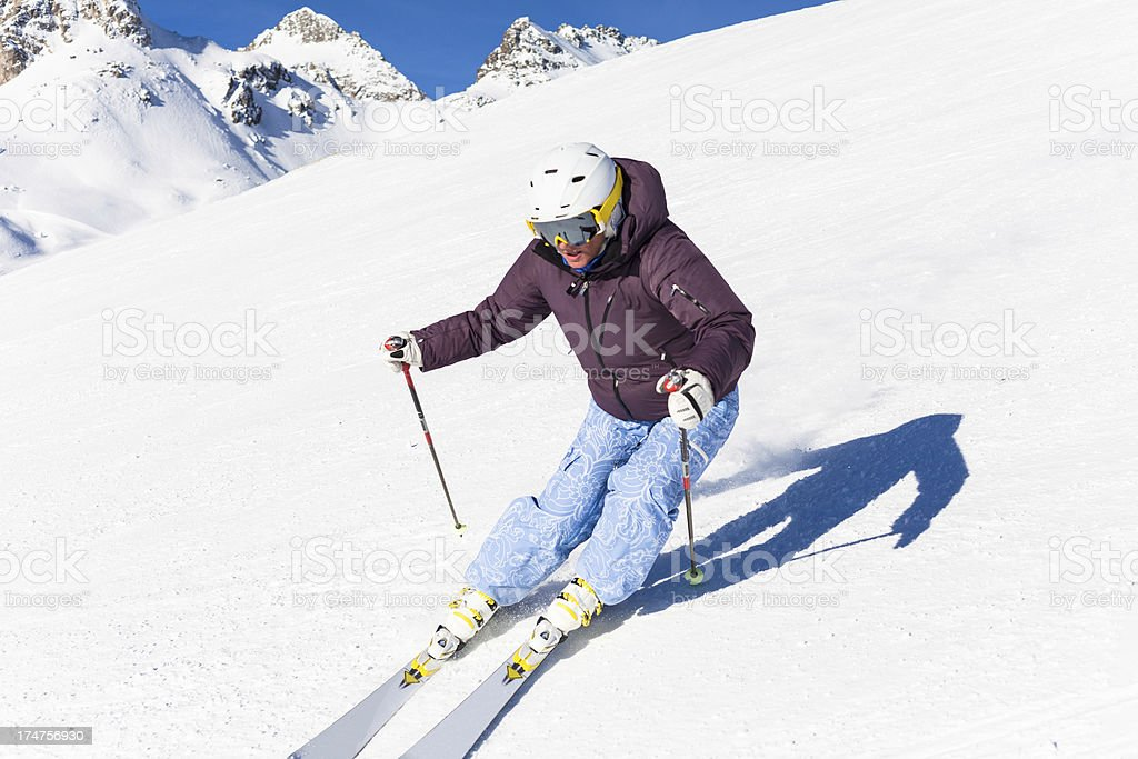 Female Skier in Action on the European Alps royalty-free stock photo