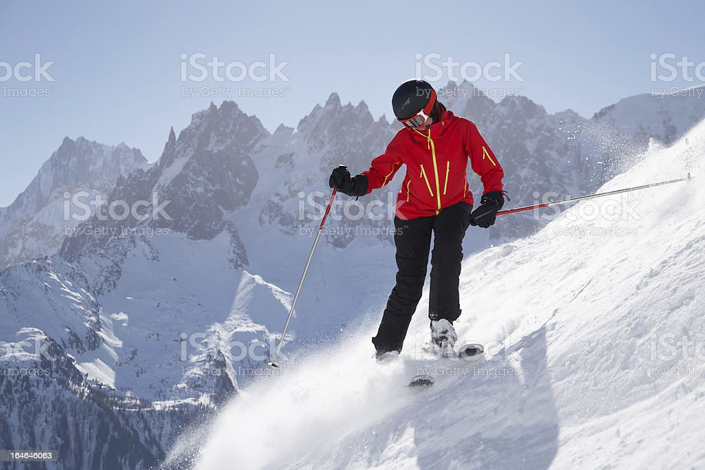 Female skier in front of mountains royalty-free stock photo