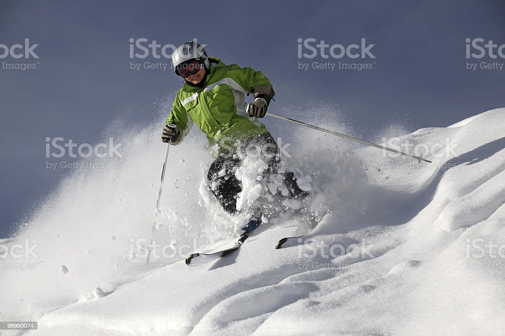 Female skier in powder snow stock photo