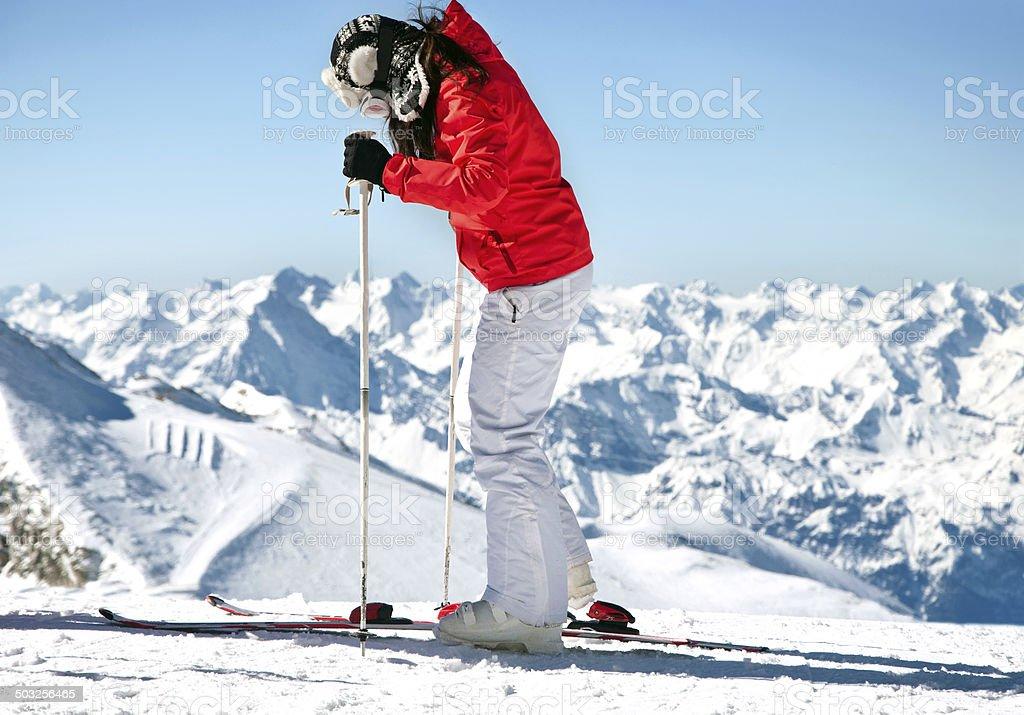 Female skier on ski slope in european alps stock photo