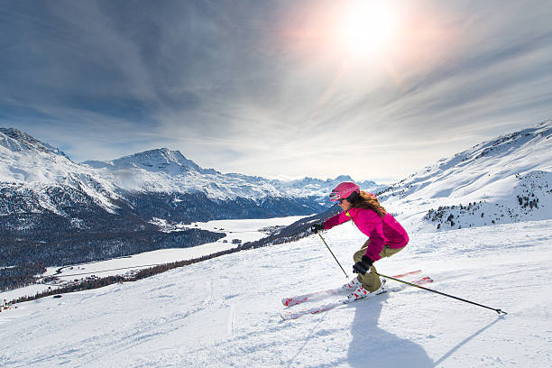Female skier on track Female skier in downhill slope ski stock pictures, royalty-free photos & images