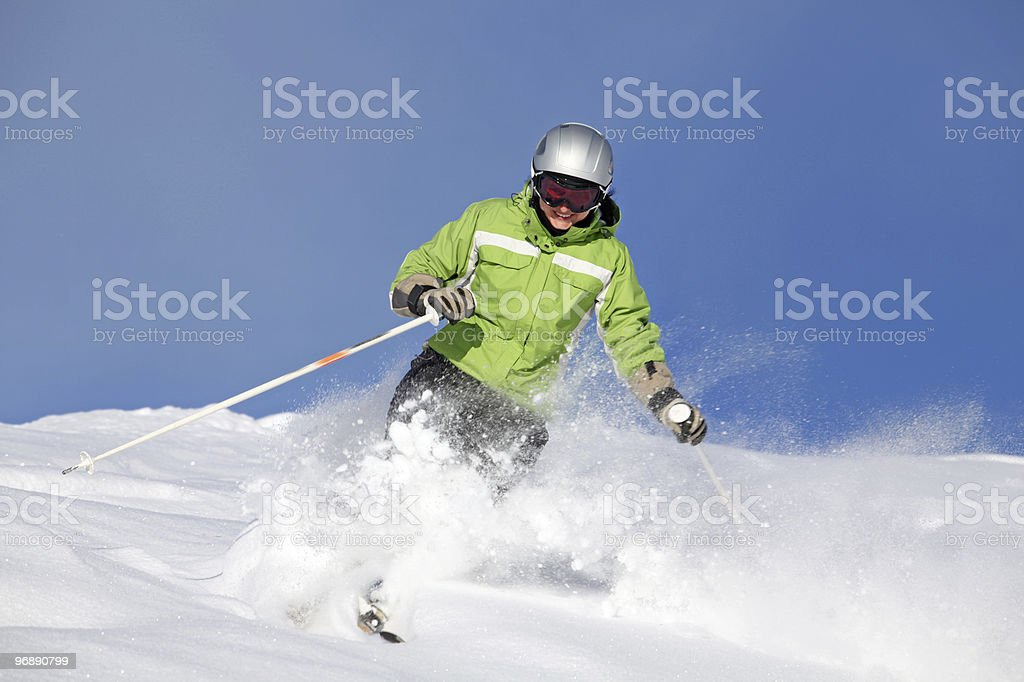 Female skier with smiley face stock photo