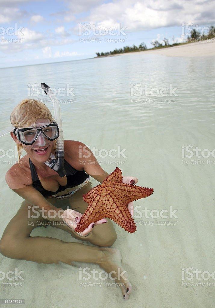 Female Skindiver with Starfish stock photo