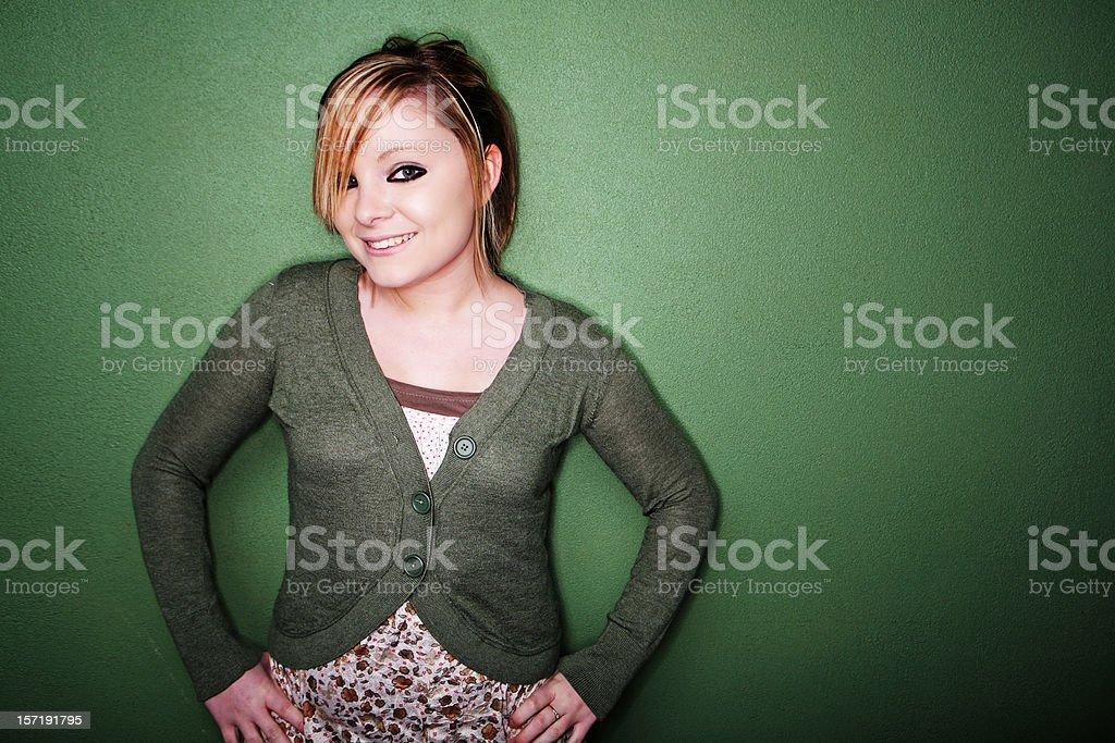 Female Smiling against Horizontal Wall royalty-free stock photo
