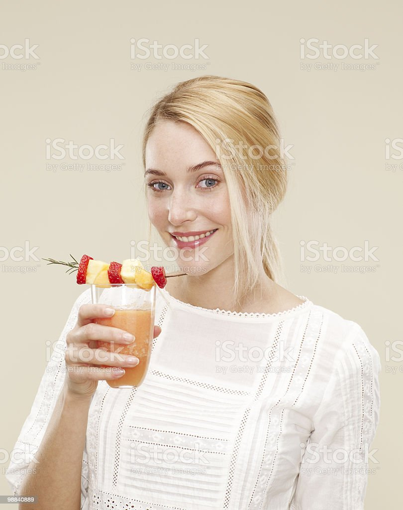 female smiling as she drinks a fruit smoothie foto de stock libre de derechos