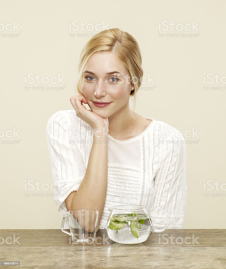 female smiling with fresh brewing tea royalty-free stock photo