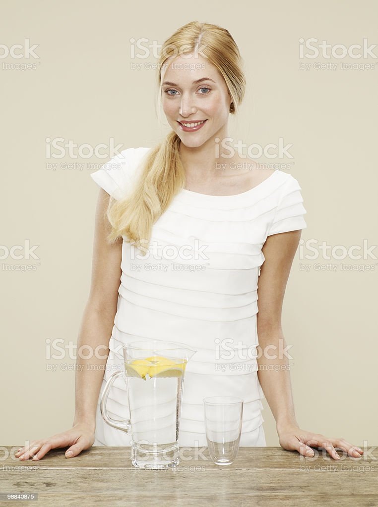 female smiling with glass and jug of cold water foto de stock royalty-free