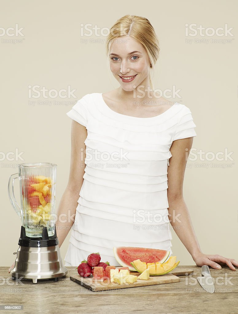 female smiling with ingredients for fruit smoothie royalty-free stock photo