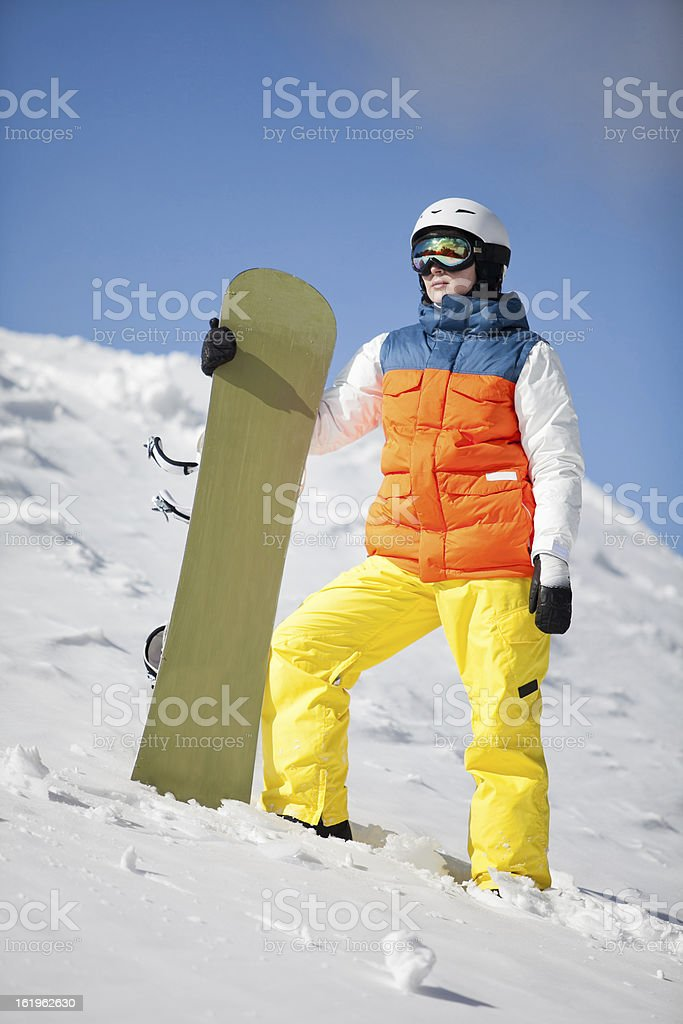 female snowboarder against sun and sky royalty-free stock photo