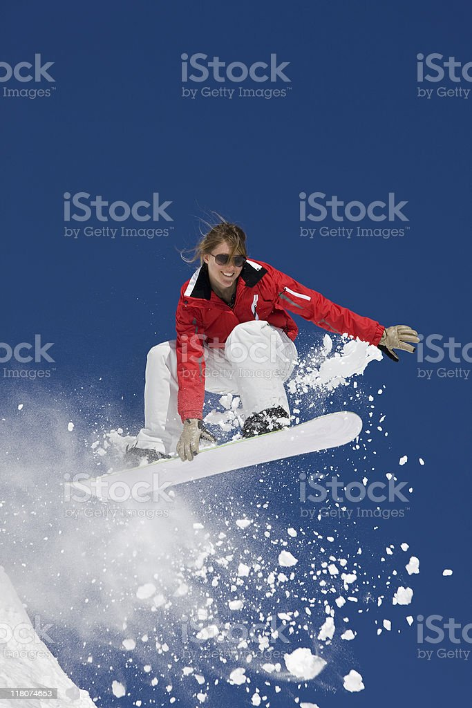 Female Snowboarder Flying In The Air royalty-free stock photo