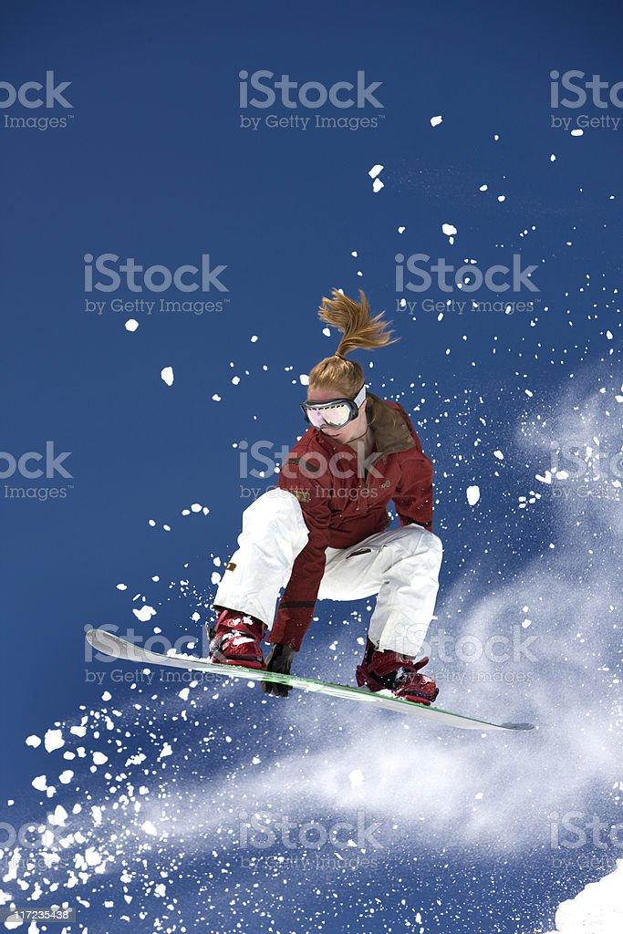 Female Snowboarder In Flight royalty-free stock photo