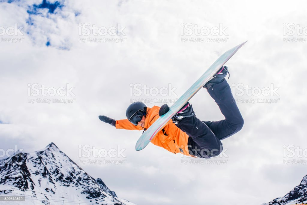 Female snowboarder in mid air stock photo