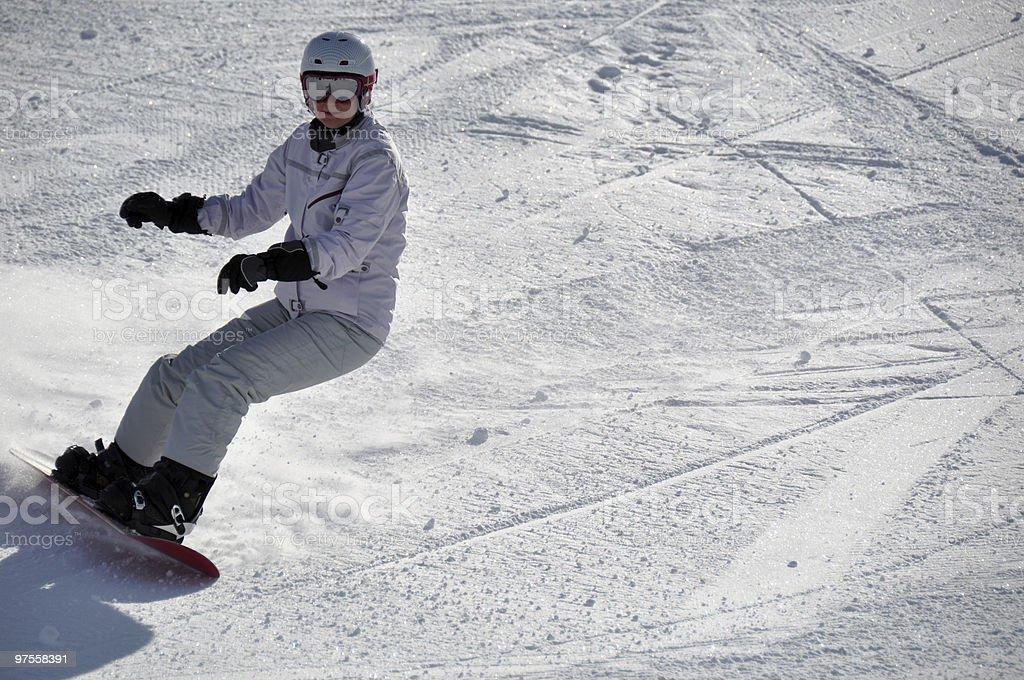 Female snowboarder in powder snow royalty-free stock photo