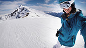 Female snowboarder selfie