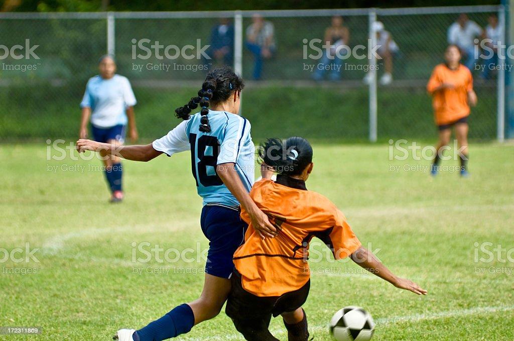 Female soccer ball battle royalty-free stock photo